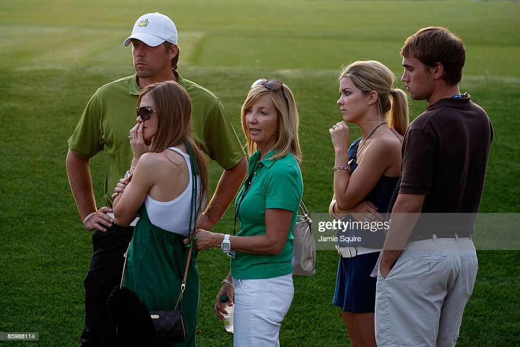 Sandy Perry, wife of Kenny Perry, and her family watch the play during the sudden death playoffduring the final round of the 2009 Masters Tournament at Augusta National Golf Club on April 12, 2009 in Augusta, Georgia.