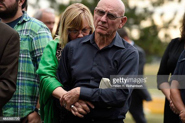 Sandy Phillips mother of Aurora shooting victim Jessica Ghawi hugs her husband Lonnie before addressing members of the media about their reactions to...