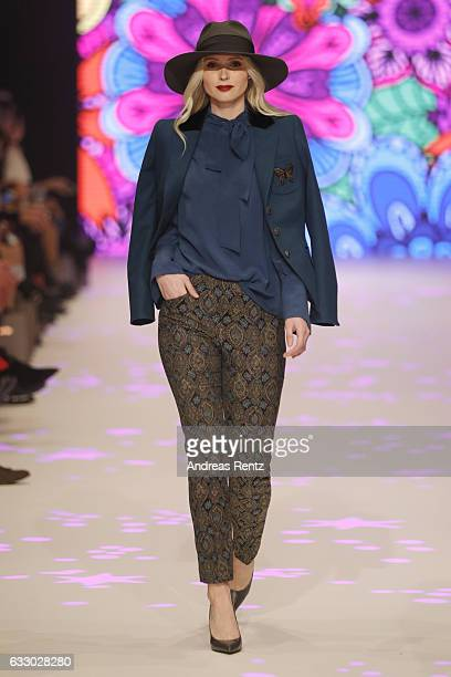 Sandy Provazek walks the runway at the Thomas Rath show during Platform Fashion January 2017 at Areal Boehler on January 29 2017 in Duesseldorf...