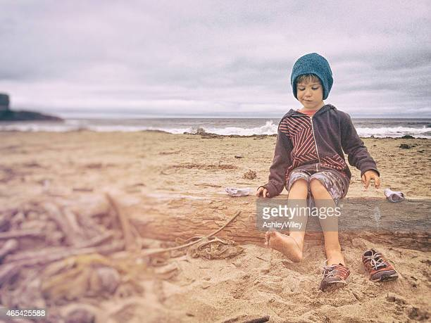 Sandy toes on young boy