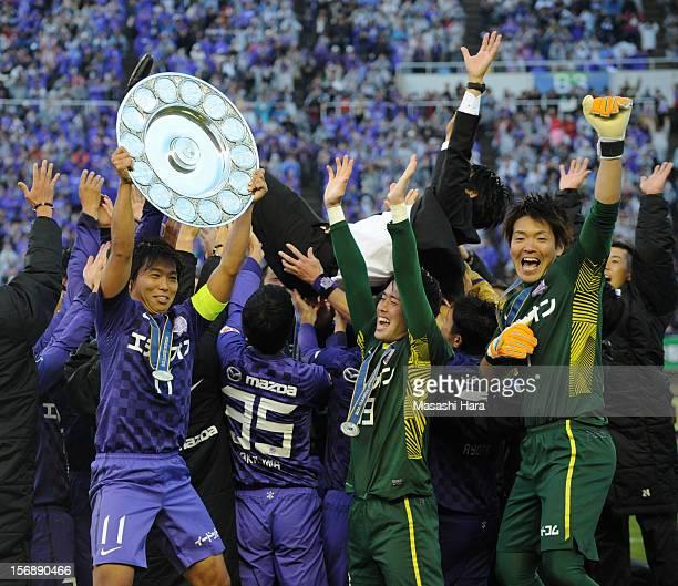 Sanfecce Hiroshima players celebrate after the JLeague match between Sanfrecce Hiroshima and Cerezo Osaka at Hiroshima Big Arch on November 24 2012...