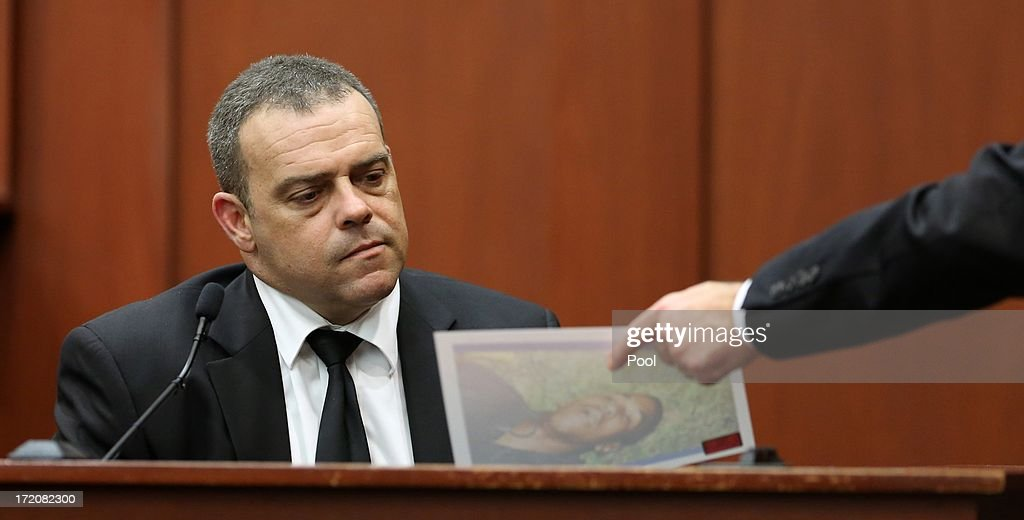 Sanford police officer Chris Serino is shown a photo of a slain Trayvon Martin from the night of the shooting, by prosecutor Bernie de la Rionda, at the George Zimmerman trial in Seminole circuit court July 1, 2013 in Sanford, Florida. Zimmerman is charged with second-degree murder for the February 2012 shooting death of 17-year-old Trayvon Martin.