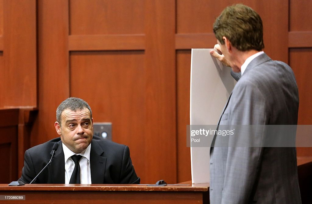Sanford police officer Chris Serino is shown a photo of George Zimmerman from the night of the Trayvon Martin shooting by defense attorney Mark O'Mara, at the George Zimmerman trial in Seminole circuit court, July 1, 2013 in Sanford, Florida. Zimmerman is charged with second-degree murder for the February 2012 shooting death of 17-year-old Trayvon Martin.