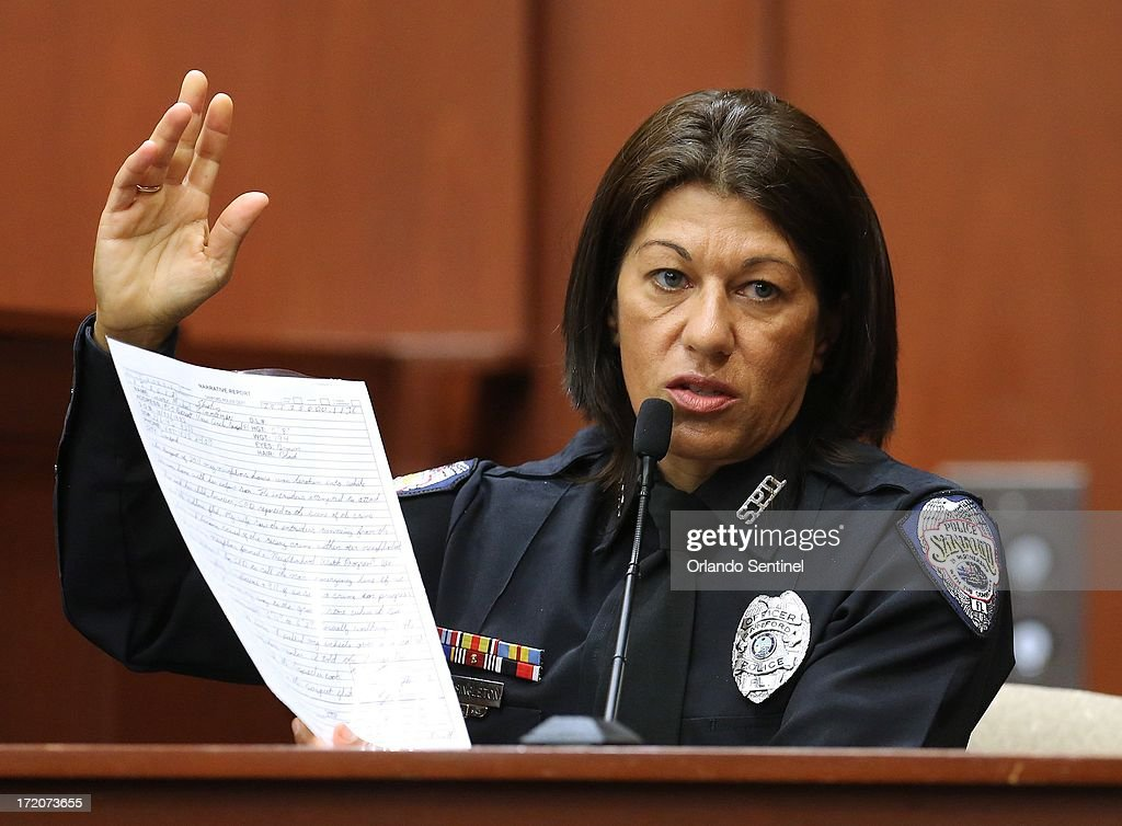 Sanford police officer Doris Singleton holds up a copy of George Zimmerman's written statement from the night of the shooting while testifying in his trial in Sanford, Florida, Monday, July 1, 2013. Zimmerman is accused in the fatal shooting of Trayvon Martin.