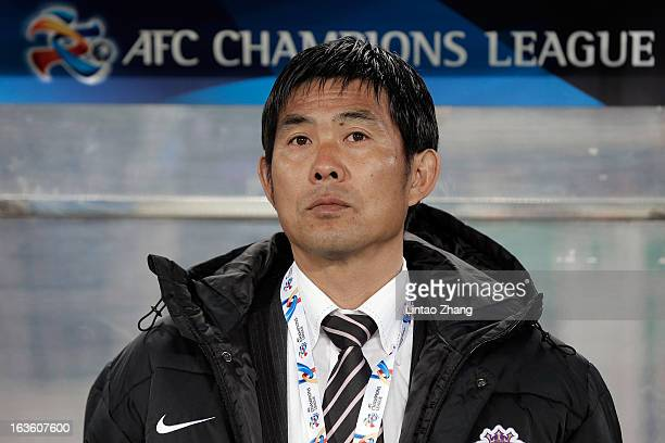 Sanfrecce Hiroshima coach Hajime Moriyasu looks on during the AFC Champions League Group match between Hiroshima Sanfrecce and Beijing Guoan at...