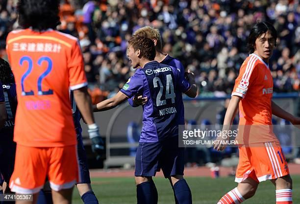 Sanfrecce Hiroshima Gakuto Notsuda celebrates his goal with his teammates while Yokohama FMarinos Yuji Nakazawa and Shunsuke Nakamura look on during...