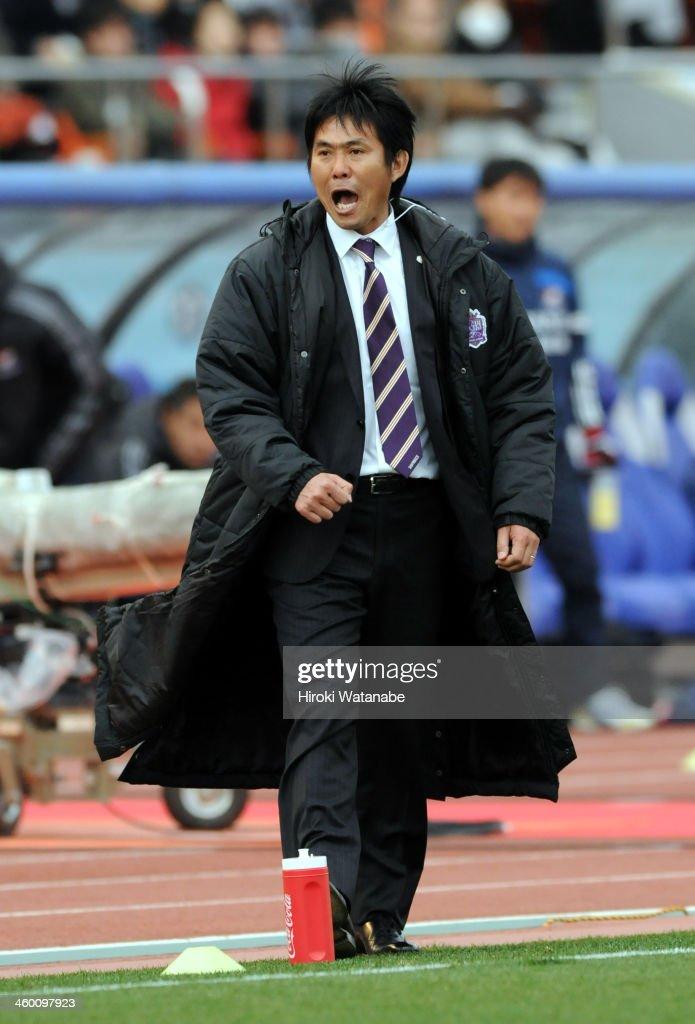 Sanfrecce Hiroshima head coach Hajime Moriyasu gestures during the 93rd Emperor's Cup final between Yokohama F.Marinos and Sanfrecce Hiroshima at the National Stadium on January 1, 2014 in Tokyo, Japan.