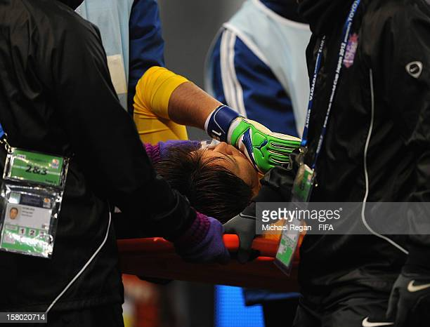 Sanfrecce Hiroshima keeper Shusaku Nishikawa is taken off injured during the FIFA Club World Cup Quarter Final match between Sanfrecce Hiroshima and...