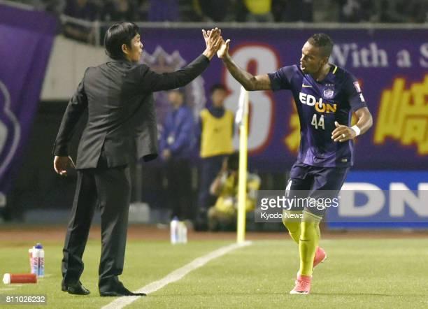 Sanfrecce Hiroshima manager Hajime Moriyasu highfives with Anderson Lopes during a game against Vissel Kobe in Hiroshima on May 6 2017 Moriyasu...