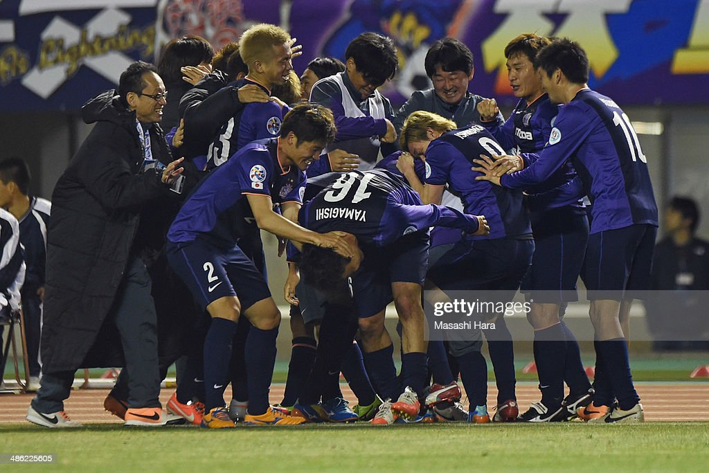 Sanfrecce Hiroshima players celebrate the first goal by Satoru Yamagichi #16 during the AFC Champions League Group F match between Sanfrecce Hiroshima and Central Coast Mariners at Edion Stadiam Hiroshima on April 23, 2014 in Hiroshima, Japan.