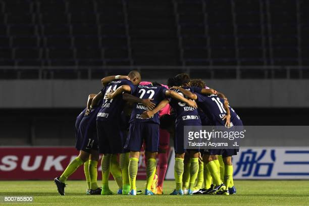 Sanfrecce Hiroshima players huddle during the JLeague J1 match between Sanfrecce Hiroshima and Omiya Ardija at Edion Stadium on June 25 2017 in...