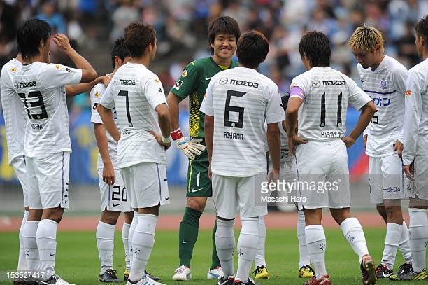 Sanfrecce Hiroshima players talk during the JLeague match between Yokohama FMarinos and Sanfrecce Hiroshima at Nissan Stadium on October 6 2012 in...