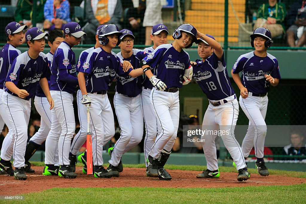 Sang Hoon Han #5 of Team Asia-Pacific celebrates after hitting a solo home run against Team Japan during fifth inning of the International Championship game of the Little League World Series at Lamade Stadium on August 23, 2014 in South Williamsport, Pennsylvania. Team Asia-Pacific defeated Team Japan 12-3.