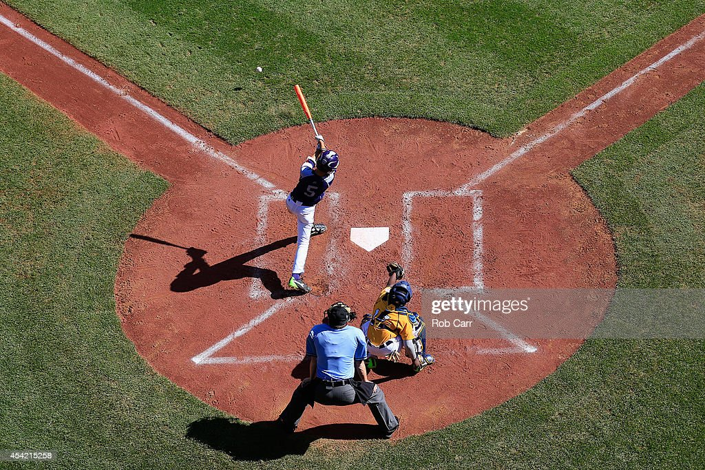 Sang Hoon Han #5 of Team Asia-Pacific follows his hit against the Great Lakes Team from Chicago, Illinois during the Little League World Series Championship game at Lamade Stadium on August 24, 2014 in South Williamsport, Pennsylvania.
