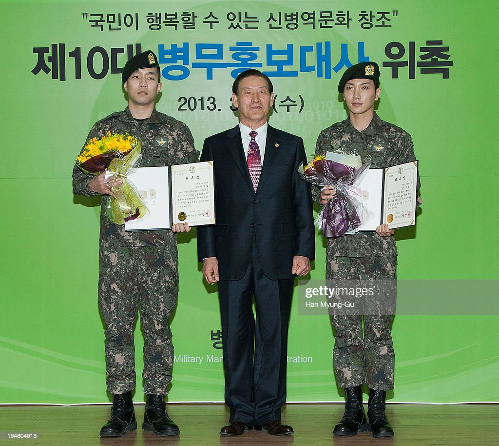 Sangchoo (237 AKA Sangchoo) of South Korean boy band Mighty Mouth, Leeteuk of South Korean boy band Super Junior and Park Chang-Myung (C) Commissioner of The Military Manpower Administration pose for media during Appointed As Honorary Ambassador For Military Manpower Administration on March 27, 2013 in Seoul, South Korea.