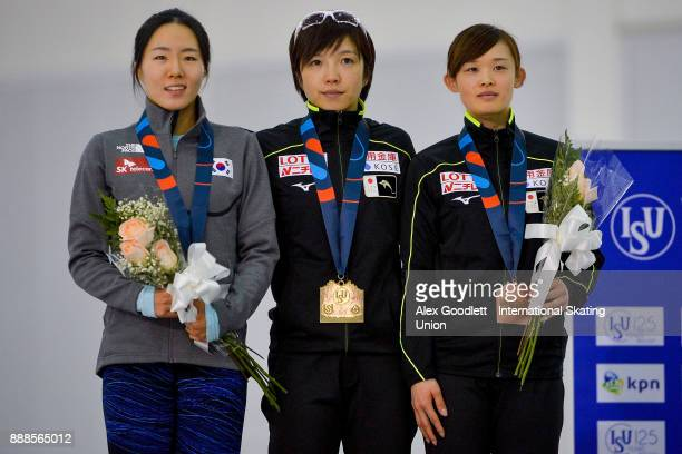 SangHwa Lee of Korea Nao Kodaira of Japan and Arisa Go of Japan stand on the podium after the Ladies 500 meter race during the ISU World Cup Short...