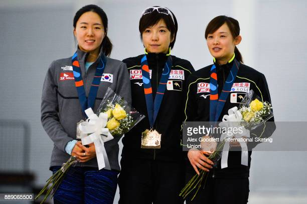 SangHwa Lee of Korea Nao Kodaira of Japan and Arisa Go of Japan stand on the podium after the ladies 500 meter race during day 2 of the ISU World Cup...