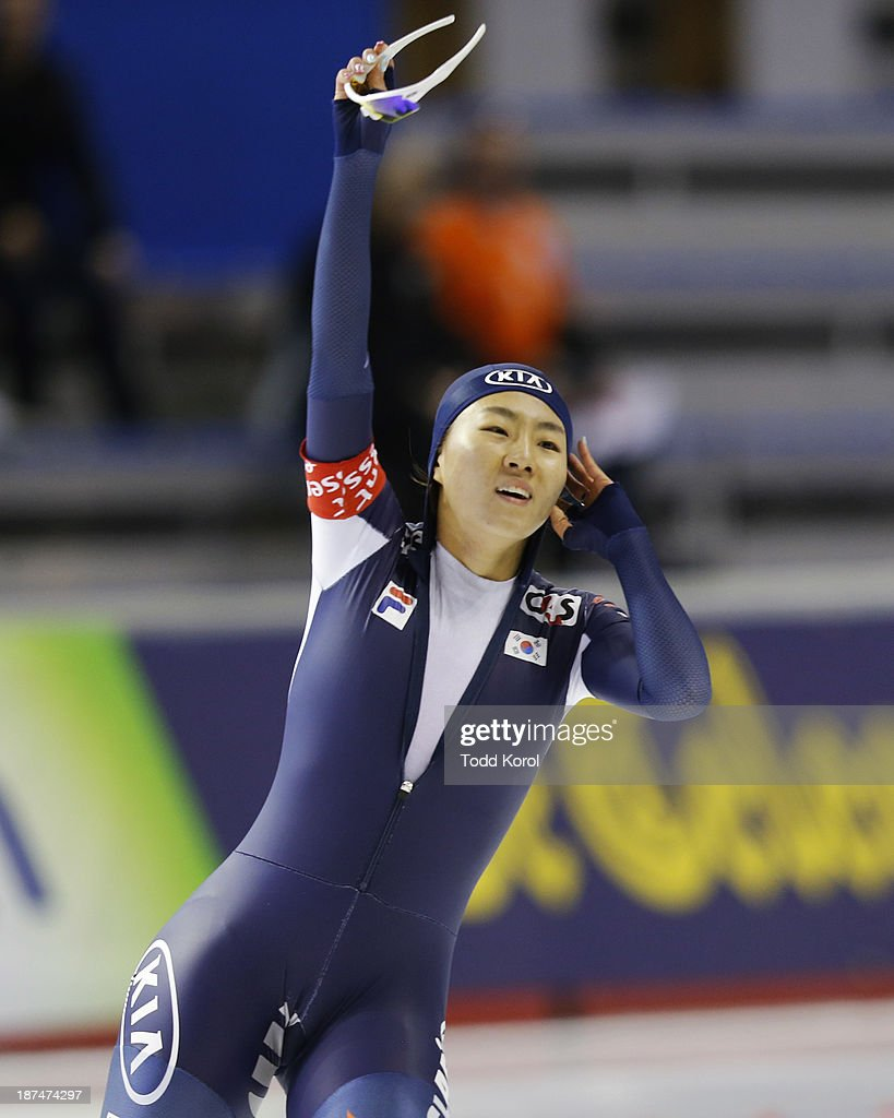 Sang-Hwa Lee of Korea reacts to setting a new world record in the women's 500 meter race during the ISU World Cup Speed Skating event November 9, 2013 in Calgary, Alberta, Canada.