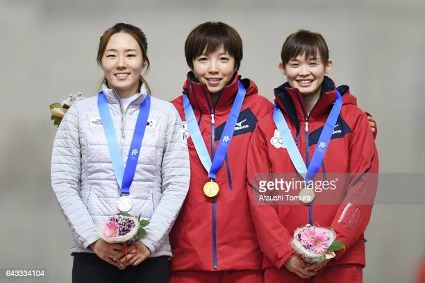 SangHwa Lee of South Korea Nao Kodaira of Japan and Arisa Go of Japan pose on the podium during award ceremony for the Speed Skating ladies 500m on...