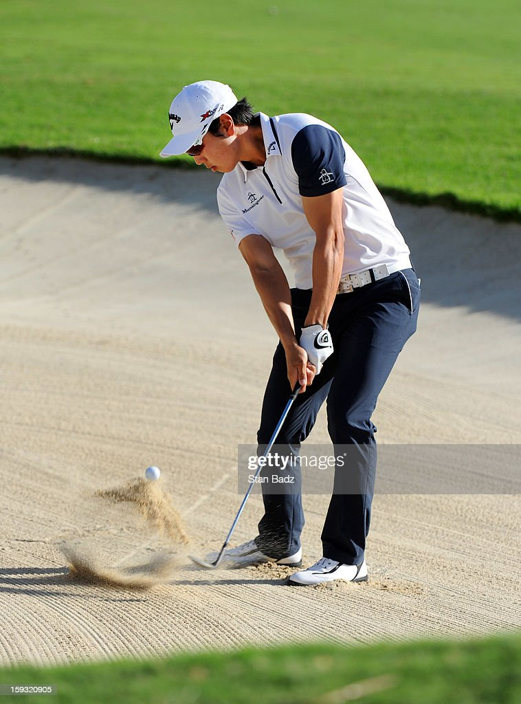 Sang-Moon Bae hits from a bunker on the 18th hole during the second round of the Sony Open in Hawaii at Waialae Country Club on January 11, 2013 in Honolulu, Hawaii.