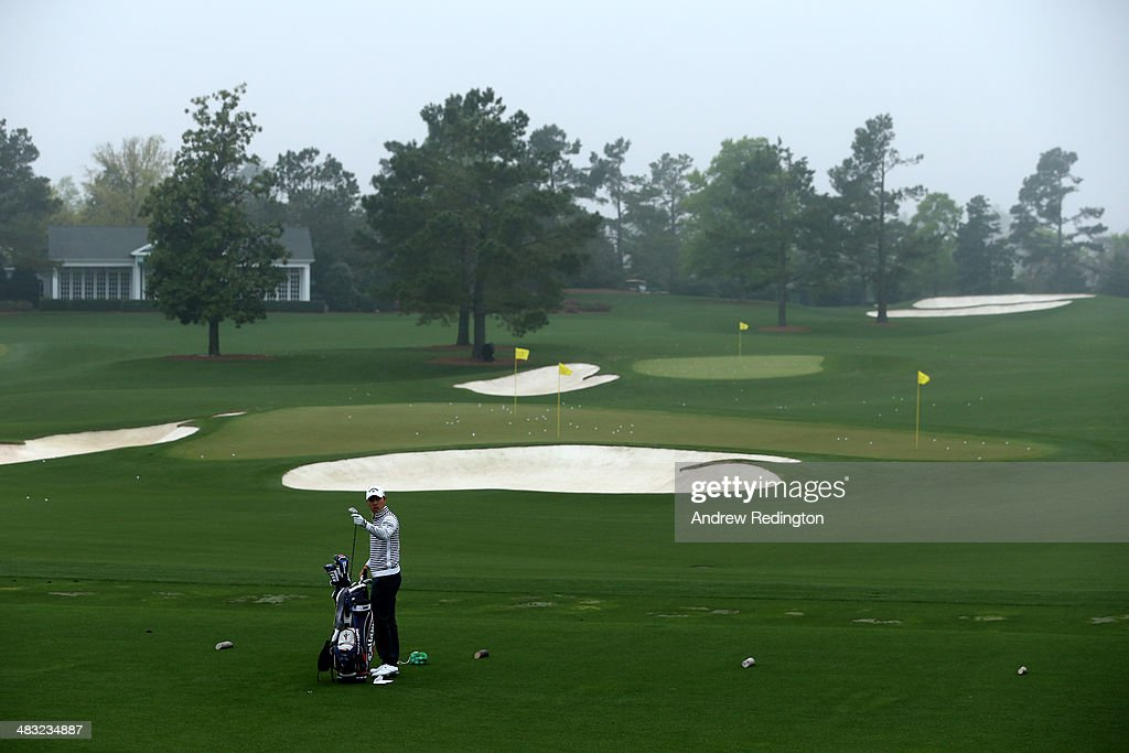 Sang-Moon Bae of Korea pulls a club from his bag on the driving range during a practice round prior to the start of the 2014 Masters Tournament at Augusta National Golf Club on April 7, 2014 in Augusta, Georgia.
