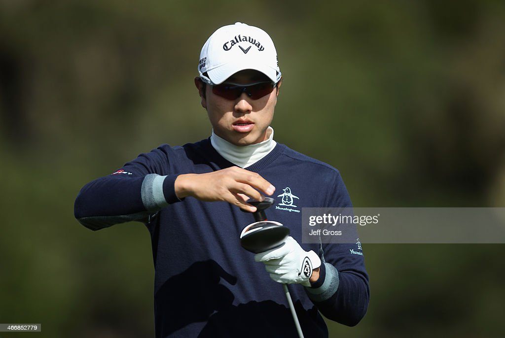 Sang-Moon Bae of South Korea adjusts his club head during a practice round for the AT&T Pebble Beach National Pro-Am at Pebble Beach Golf Links on February 4, 2014 in Pebble Beach, California.