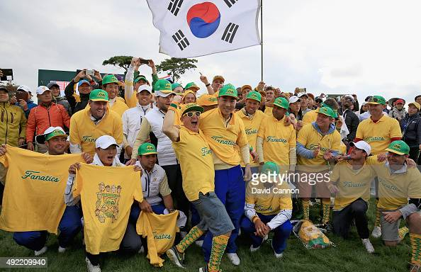 Sangmoon Bae of South Korea and other members of the International team pose in amongst the Australian 'Fanatics' after the final match during the...