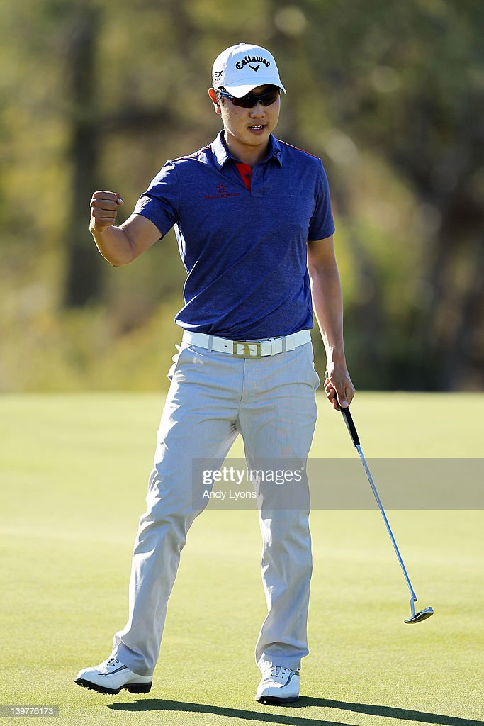 Sangmoon Bae of South Korea celebrates winning his match against John Senden of Australia on the 18th hole during the third round of the World Golf...