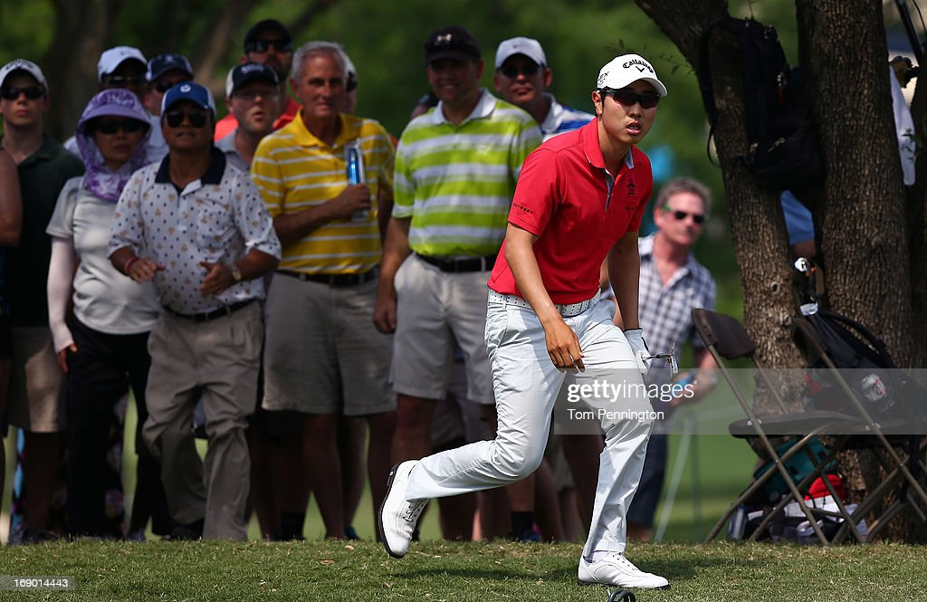 Sang-Moon Bae of South Korea follows a shot out of the rough during the third round of the 2013 HP Byron Nelson Championship at the TPC Four Seasons Resort on May 18, 2013 in Irving, Texas.