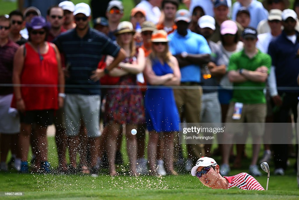 Sang-Moon Bae of South Korea hits a shot out of a sand trap during the final round of the 2013 HP Byron Nelson Championship at the TPC Four Seasons Resort on May 19, 2013 in Irving, Texas.