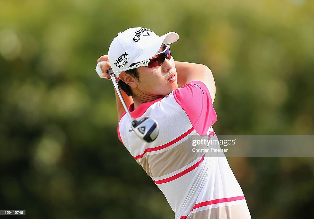 Sang-Moon Bae of South Korea hits a tee shot on the 16th hole during the third round of the Sony Open in Hawaii at Waialae Country Club on January 12, 2013 in Honolulu, Hawaii.