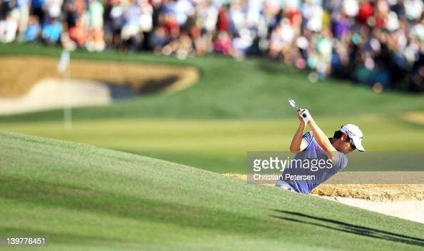 Sangmoon Bae of South Korea hits his second shot from a bunker on the 18th hole during the third round of the World Golf ChampionshipsAccenture Match...