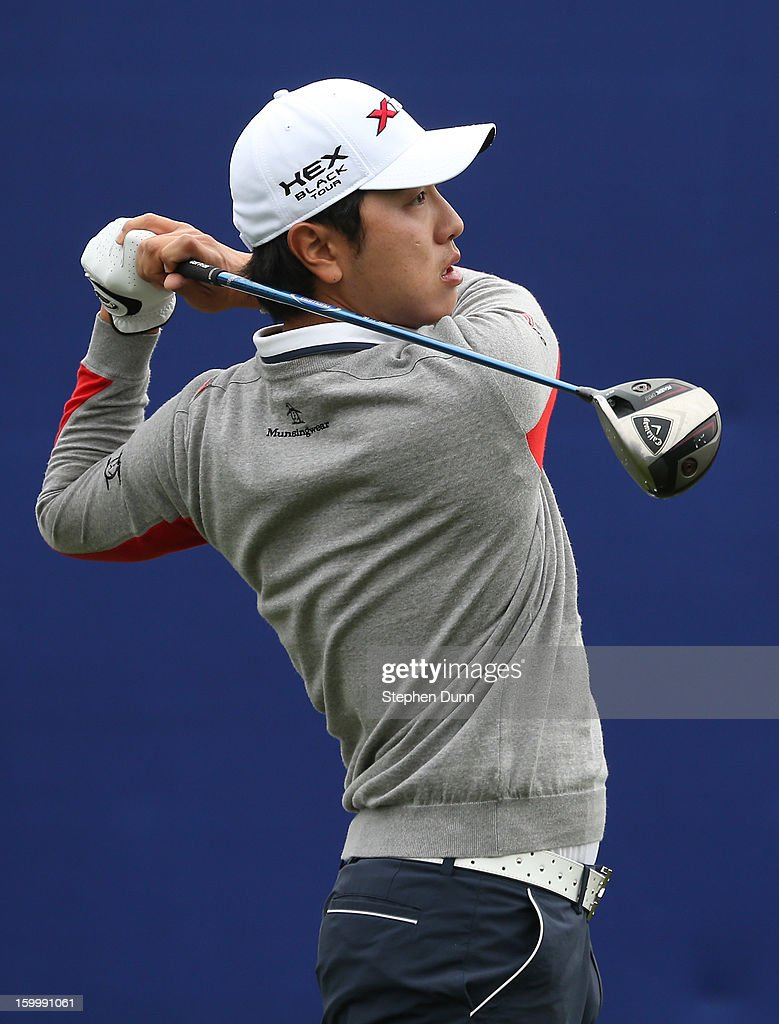 Sang-Moon Bae of South Korea hits his tee shot on the seventh hole during the first round of the Farmers Insurance Open on the South Course at Torrey Pines Golf Course on January 24, 2013 in La Jolla, California.