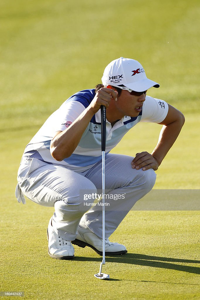 Sang-Moon Bae of South Korea lines up his putt on the ninth hole during the first round of the Waste Management Phoenix Open at TPC Scottsdale on January 31, 2013 in Scottsdale, Arizona.
