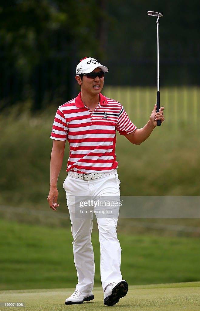 Sang-Moon Bae of South Korea reacts to a putt during the final round of the 2013 HP Byron Nelson Championship at the TPC Four Seasons Resort on May 19, 2013 in Irving, Texas.