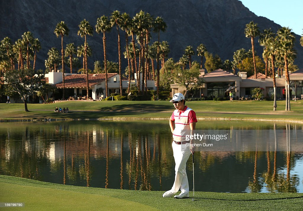 Sang-Moon Bae of South Korea waits to putt on the 18th hole during the final round of the Humana Challenge In Partnership With The Clinton Foundation on the Palmer Private Course at PGA West on January 20, 2013 in La Quinta, California.