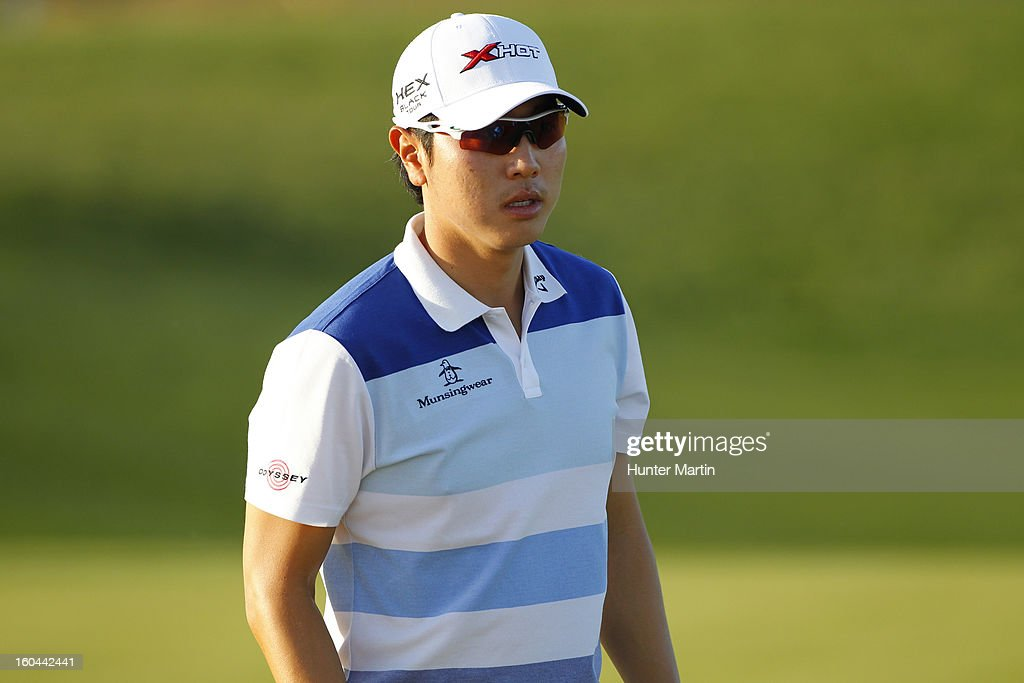 Sang-Moon Bae of South Korea walks off the green on the ninth hole during the first round of the Waste Management Phoenix Open at TPC Scottsdale on January 31, 2013 in Scottsdale, Arizona.