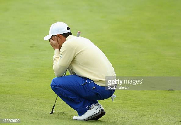 SangMoon Bae of the International Team reacts to a poor pitch shot on the 18h hole in his match against Bill Haas of the United States during the...