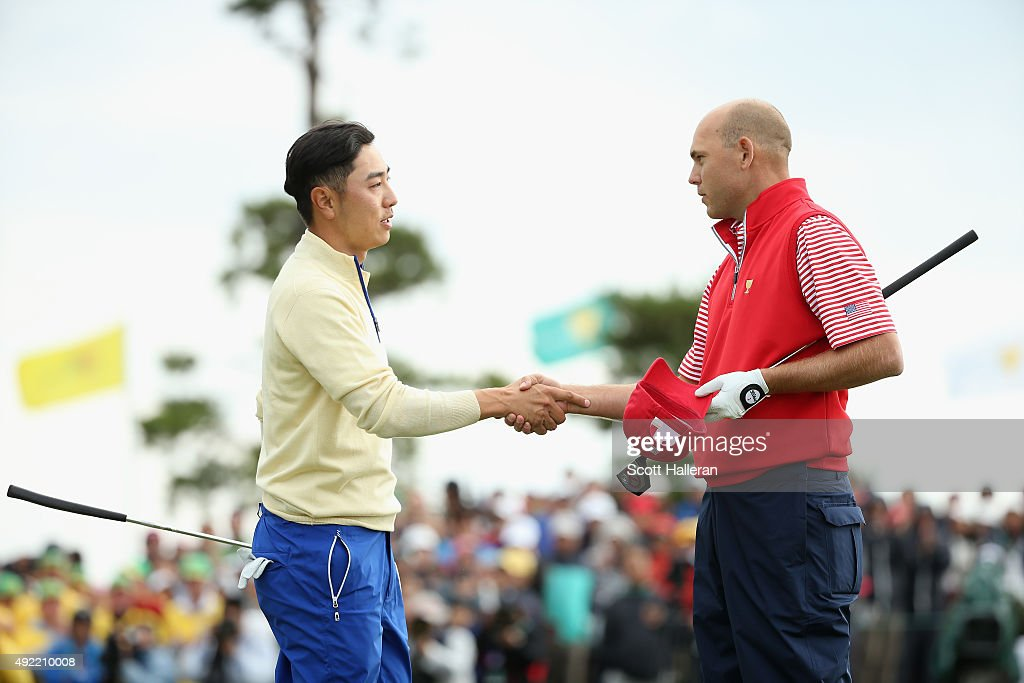 Sang-Moon Bae of the International Team (L) shakes hands with <a gi-track='captionPersonalityLinkClicked' href=/galleries/search?phrase=Bill+Haas&family=editorial&specificpeople=646978 ng-click='$event.stopPropagation()'>Bill Haas</a> of the United States Team on the 18h green after Haas won the match 2up during the Sunday singles matches at The Presidents Cup at Jack Nicklaus Golf Club Korea on October 11, 2015 in Songdo IBD, Incheon City, South Korea.