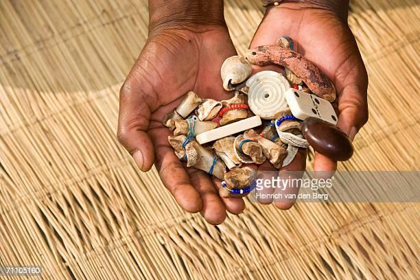 Sangoma (Traditional Healer) Hands Holding Bones