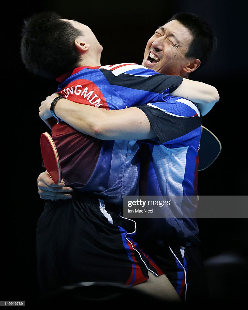 Sanguen Oh and Seungmin Ryu of South Korea celebrate victory over Chu Yan Leung and Tianyi Jiang of Hong Kong in the semi final of the men's team competition on Day 10 of the London 2012 Olympic Games at ExCeL on August 6, 2012 in London, England.