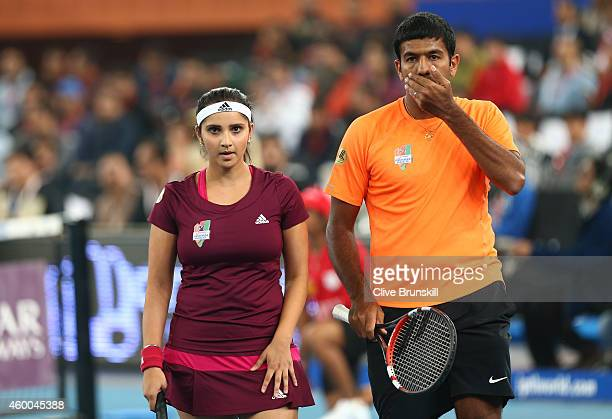 Sania Mirza and Rohan Bopanna of the Indian Aces show their dejection against Daniel Nestor and Kirsten Flipkens of the Manila Mavericks during the...