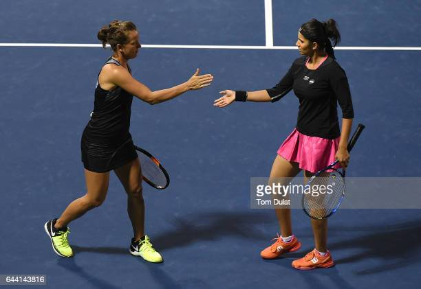Sania Mirza of India and Barbora Strycova of Czech Republic celebrate a point during their match against Abigail Spears of United States and Katarina...