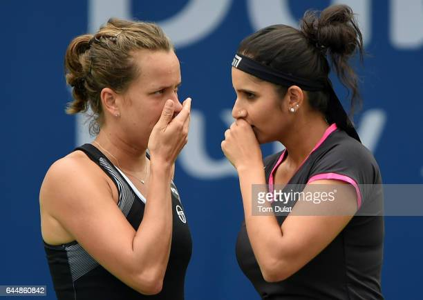 Sania Mirza of India and Barbora Strycova of Czech Republic discuss tactics during their semi final match against Ekaterina Makarova of Russia and...