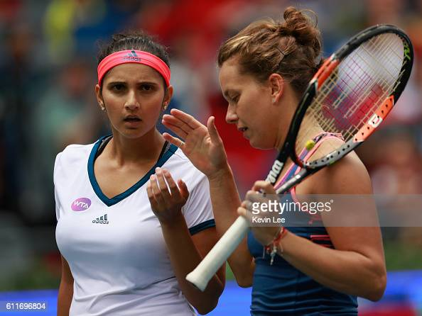 Sania Mirza of India and Barbora Strycova of Czech Republic in action against Lucie Safarova of Czech Republic and Bethanie MattekSands of United...
