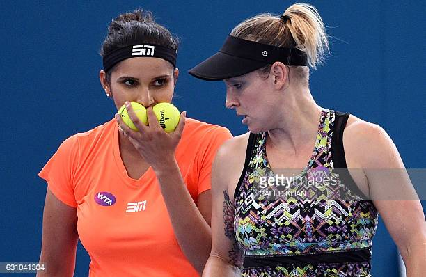 Sania Mirza of India and Bethanie MattekSands of the US draws a strategy against Taiwan's SuWei Hsieh in their women's double semifinal match at the...