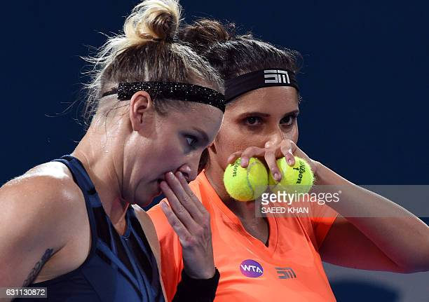 Sania Mirza of India and Bethanie MattekSands of the US talk between points against Russia's Ekaterina Makarova and Elena Vesnina in their women's...