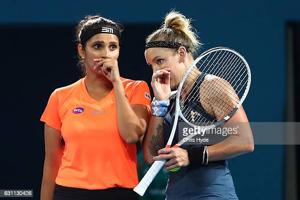 Sania Mirza of India and Bethanie MattekSands of the USA talk tactics during the Women's Doubles Final against Ekaterina Makarova of Russia and Elena...