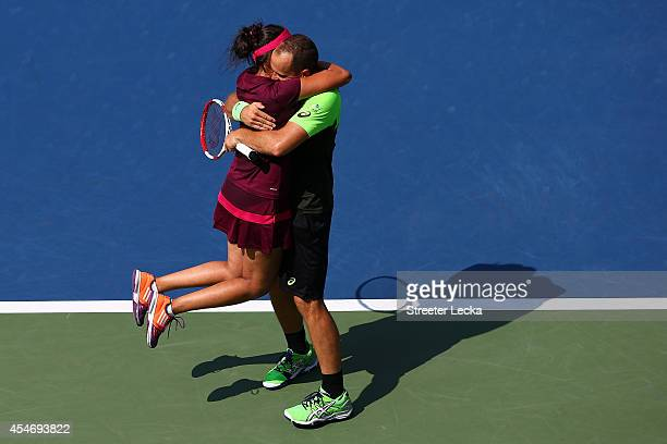 Sania Mirza of India and Bruno Soares of Brazil celebrate match point after defeating Santiago Gonzalez of Mexico and Abigail Spears of the United...