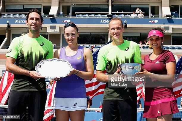 Sania Mirza of India and Bruno Soares of Brazil celebrate with the trophy after defeating Santiago Gonzalez of Mexico and Abigail Spears of the...